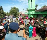 """TMMD Ke-98 Bolmong Ditutup, Senyum Bahagia Warga Lepas Prajurit TNI"""
